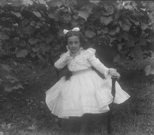 Lillian M Poe sitting in white dress ca 1900 GPN
