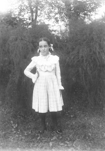 Lillian M Poe standing in white dress ca 1900 GPN