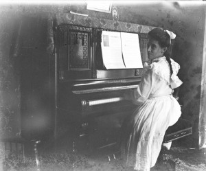 Lillian M Poe playing Calhoon piano ca 1900 GPN