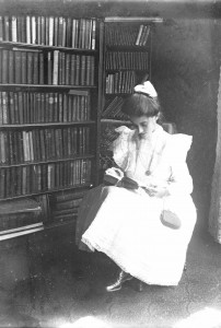 Lillian M Poe in library ca 1900 GPN
