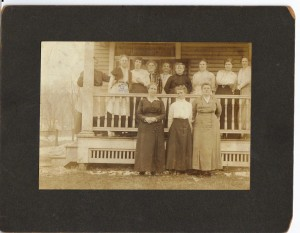 Parthenia P Calhoon standing on porch 4th from left (anna L and John F Nash Collection)